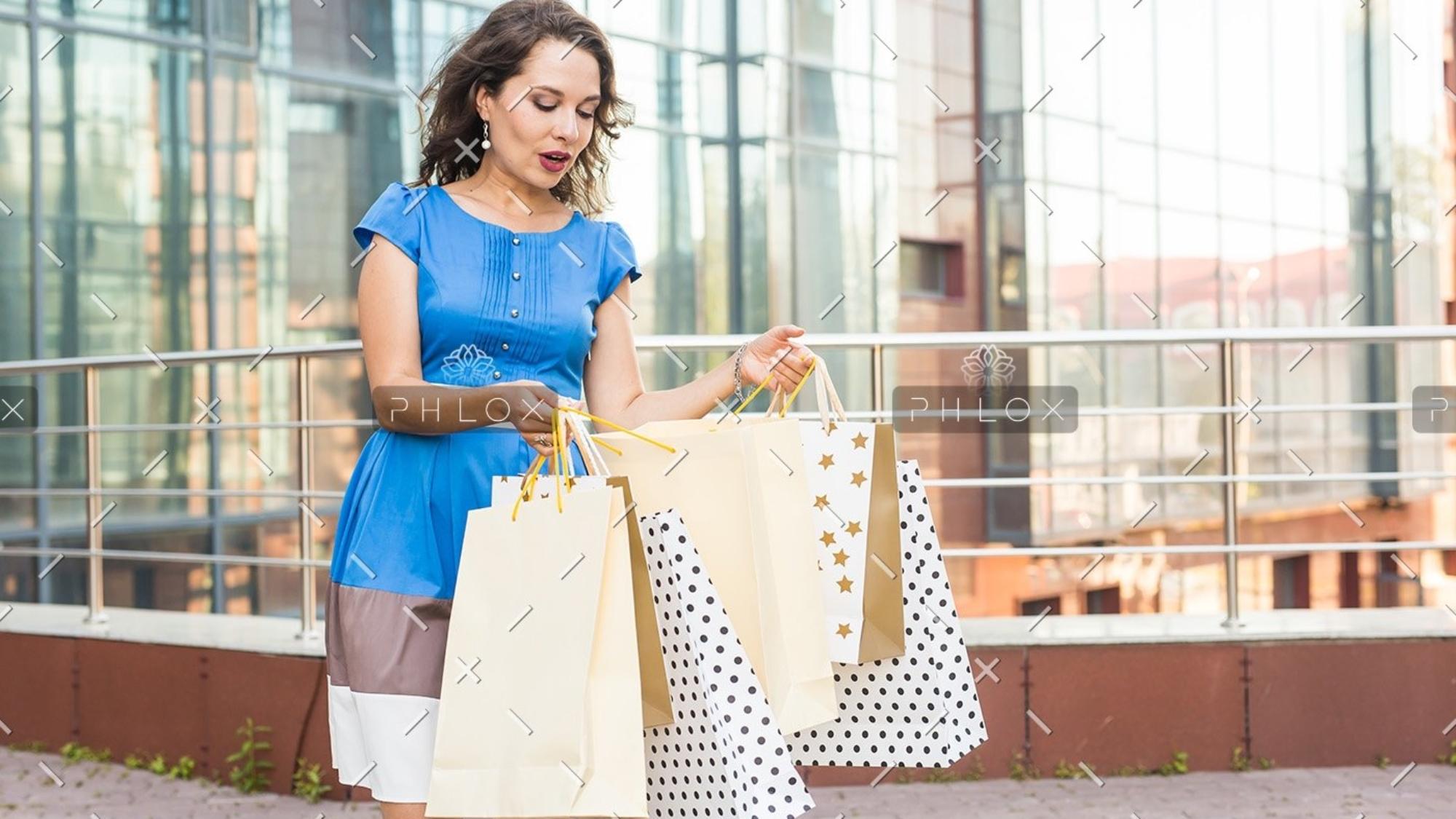 demo-attachment-154-shopper-shopaholic-shopping-woman-holding-many-PCWUSW9